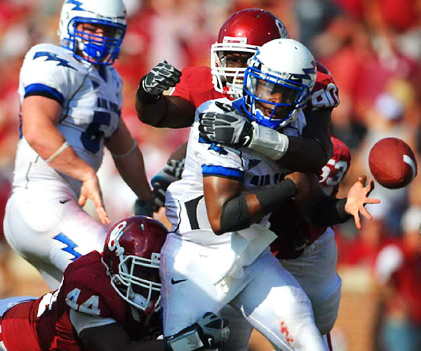 Sooner defensive end David King forces a fumble by Air Force quarterback Tim Jefferson Jr. in Oklahoma's 27-24 victory against the Falcons.