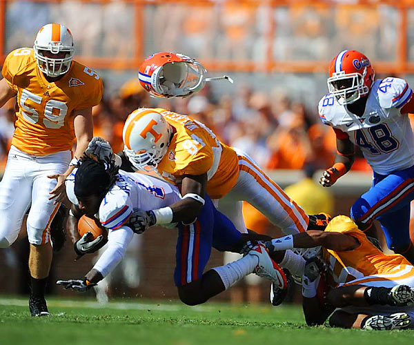Florida's Janoris Jenkins loses his helmet after being tackled by Chris Walker  of Tennessee. Running back Mike Gillislee spearheaded the Gators' 31-17 victory over the Vols in Knoxville.