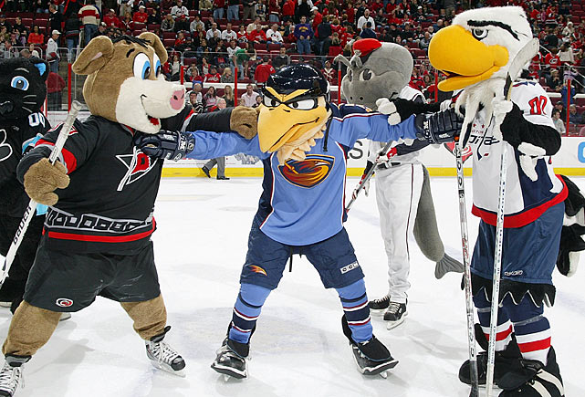 Any honest fight needs a referee, and Atlanta Thrashers mascot Thrash was all to happy to officiate this skirmish between Stormy, the Carolina Hurricanes mascot, and Slapshot, the Washington Capitals mascot.  The other mascots in the arena were smart enough to stay out of it.