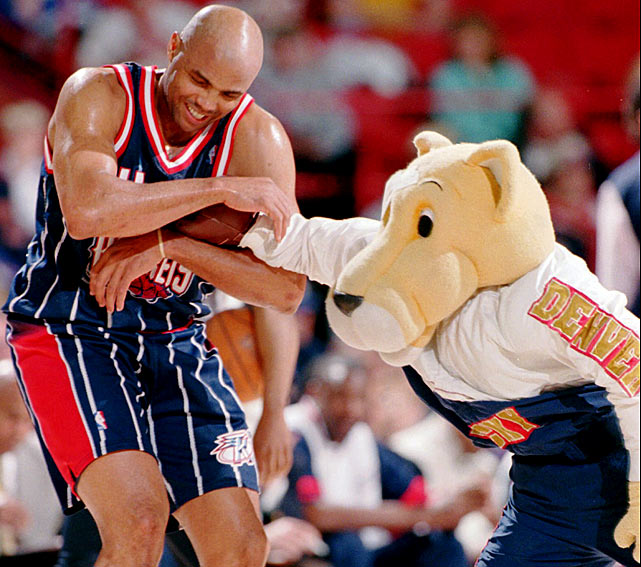 The Denver Nuggets' mascot, Rocky the Mountain Lion, and Charles Barkley usually squared off for some playful antics whenever the Rockets visited the Mile High City.  Rocky attempted to slug Barkley after the Rockets star stripped him of his costume earlier in the game, but unfortunately for Rocky -- and all mascots -- their plush mitts can turn even the most malicious jabs into tickle fights.
