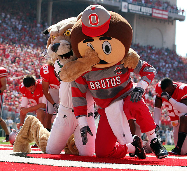 The fur was flying in Columbus, Ohio, before the kickoff of the Ohio State-Ohio University football game.  Ohio's mascot, Rufus, stalked Brutus Buckeye into the end zone, where he proceeded to punch the unsuspecting mascot several times in the head.  It was later revealed that the man inside Rufus was not even enrolled at Ohio University.  Inspired by this unique form of mascot mayhem, SI.com presents other costumed clashes from years past.
