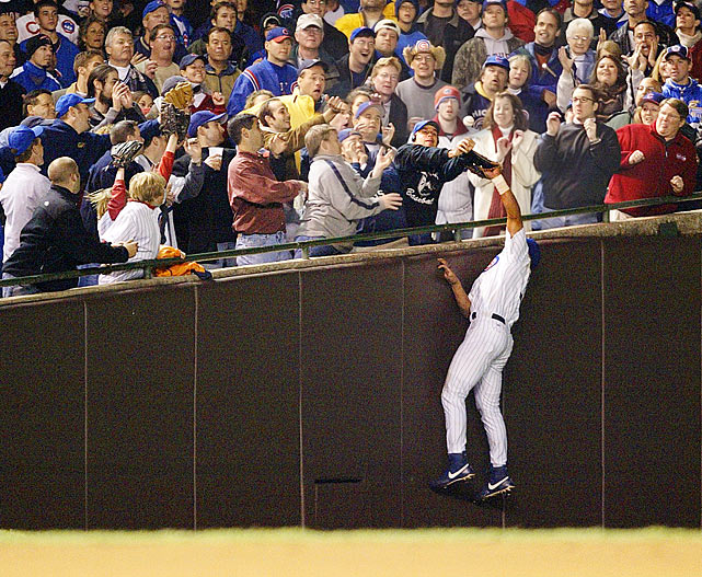In Game 6 of the 2003 NLCS, the Chicago Cubs were five outs away from their first pennant since 1945 with ace Mark Prior on the mound and a 3-0 lead on the Florida Marlins. With one  man on, Florida's Luis Castillo popped a ball near the left field stands.  Cubs outfielder Moises Alou attempted a leaping grab near the wall, but the ball was accidentally knocked away by Cubs fan Steve Bartman.  A flustered Chicago squad proceeded to give up eight runs in the 8th, as the Marlins coasted to an 8-3 victory.  Florida then beat the Cubs 9-6 in Game 7 to clinch the pennant.