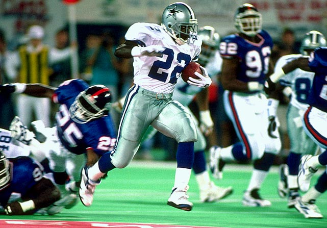 On the evening that the Giants retired Phil Simms' number, Emmitt Smith had to come in to the Meadowlands and suck the air out of the stadium.  Smith took the first handoff of the season and burst through a hole for a 60-yard touchdown.  It would be a harbinger of things to come. Smith would rush for 163 yards and tie an NFL-opening-week record with four rushing touchdowns.  The Cowboys would ride Smith all the way to the Super Bowl, where they would win their third championship in four years.