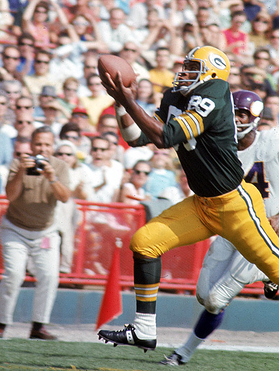 Leaping to break up a pass is Green Bay linebacker Dave Robinson, part of a stout Packers defense that held the Minnesota Vikings to just 159 passing yards during their Oct. 4 contest. Though the Packers earned a tough 13-10 victory, the Vikings would emerge triumphant in the division, going 12-2 for the year.