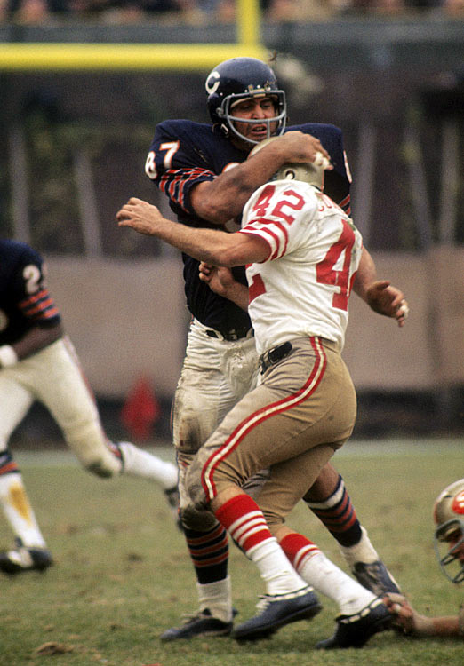 A 10-year NFL veteran, Chicago Bears linebacker Ed O'Bradovich yanks down 49ers running back Doug Cunningham during their Week 8 matchup. Though the Bears defense limited San Francisco to a mere 47 rushing yards, they allowed San Francisco quarterback John Brodie to pick them apart for 317 yards and three touchdowns as the 49ers thumped the Bears 37-16.