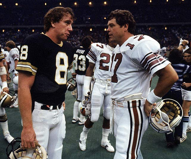 New Orleans Saints quarterback Archie Manning speaks with St. Louis Cardinals quarterback Jim Hart following their Oct. 5 game in the Superdome. Manning threw for only 49 yards in the team's 40-7 defeat, one of New Orleans' league-worst 15 losses that season.