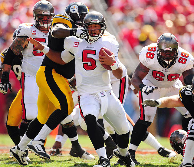 Tampa Bay quarterback Josh Freeman gets yanked down from behind.  Freeman was under heavy pressure throughout the contest, getting sacked four times.