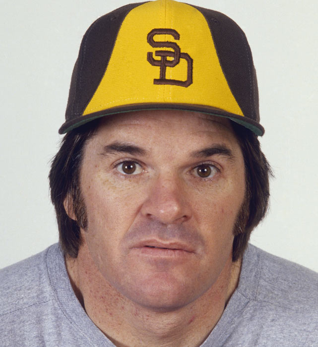 Rose tries on a Padres hat for size during a portrait session early in the 1984 season.