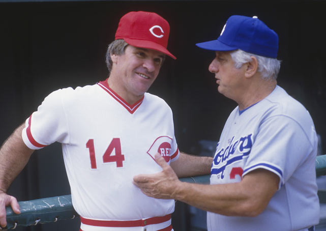 Rose chats with Tommy Lasorda before a Reds-Dodgers game at Riverfront Stadium.