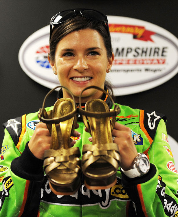 With a shiny, new pair of shoes in tow, courtesy of New Hampshire Motor Speedway's Jerry Gappens, Danica smiles for the cameras before a Nationwide race at Loudon.