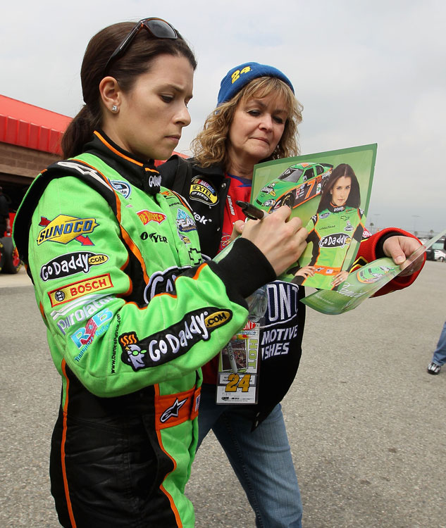 Danica signs autographs before practicing for the Stater Bros. 300 at Fontana, where she finished 31st.