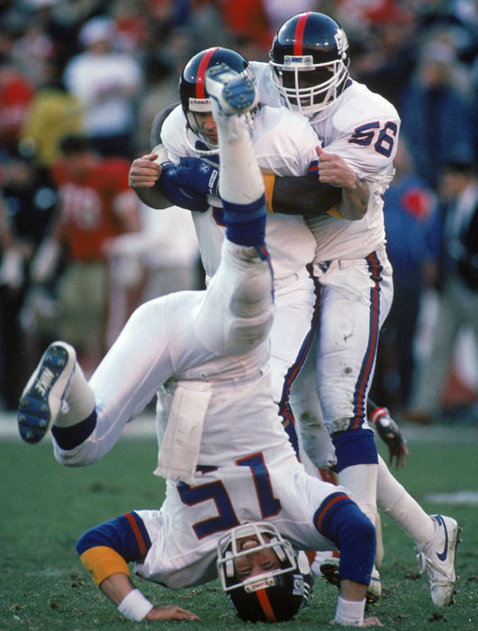 Jeff Hostetler does a headstand to celebrate Matt Bahr's last-second field goal, which gave the Giants a 15-13 victory over the 49ers and a spot in the Super Bowl.
