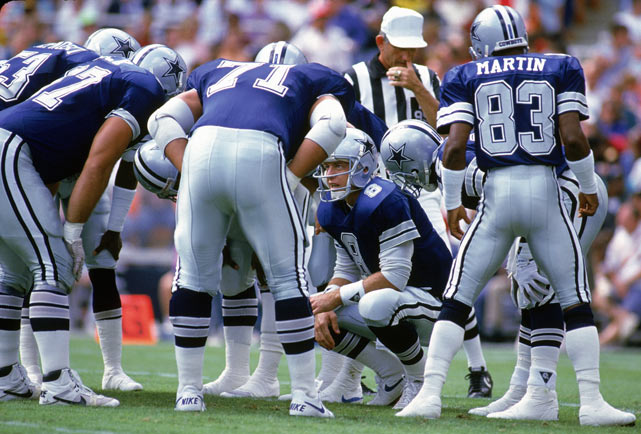 Dallas QB Troy Aikman delivers the play call during a game against Washington. Aikman, in his second NFL season, threw for 2,579 yards with 11 touchdowns and 18 interceptions.