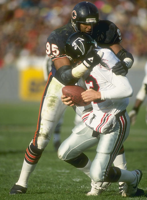 Chicago defensive lineman Richard Dent sacks Atlanta quarterback Chris Miller during a game at Soldier Field.