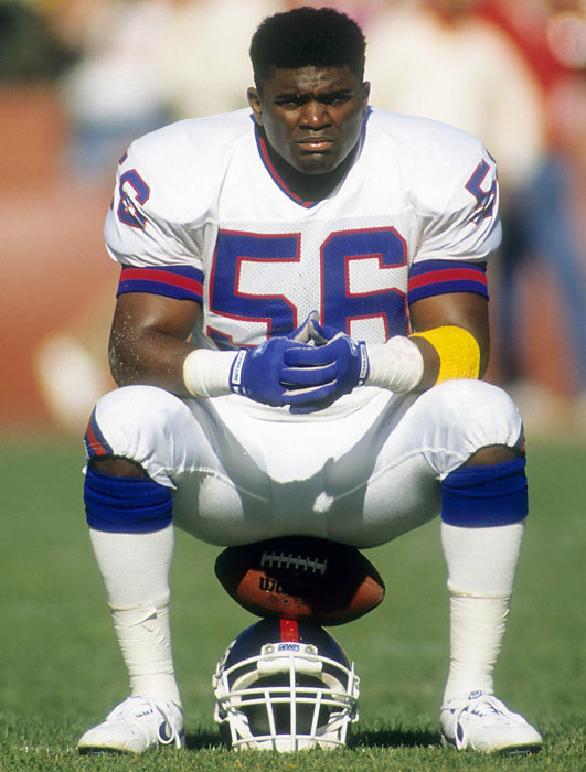 Giants linebacker Lawrence Taylor relaxes before a game against the 49ers. LT and the Giants defense led the league in fewest points allowed (211) on their way to a Super Bowl championship.