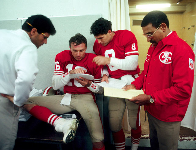 San Francisco quarterback Joe Montana compares notes with Steve Young during halftime of a 7-3 victory over the Giants.