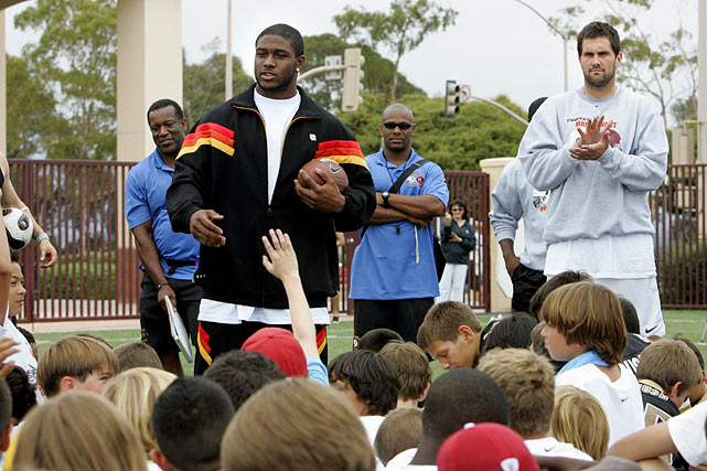 Bush speaks to children at Matt Leinart's Youth Football Camp in Santa Barbara, Calif.