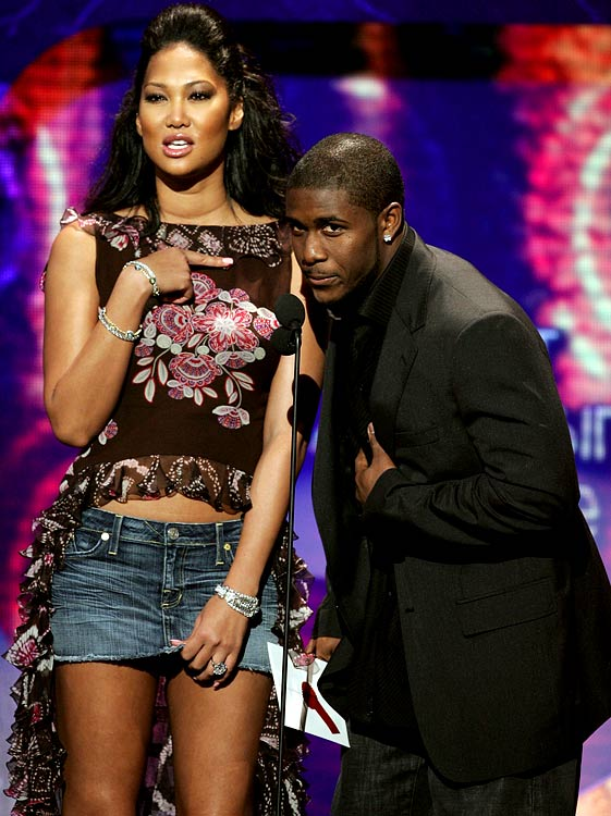 Due to his popularity in the Los Angeles region, Bush's celebrity was beginning to spread beyond the football field. In this photo, Bush is joined by Kimora Lee Simmons at the Soul Train Music Awards  in Pasadena.