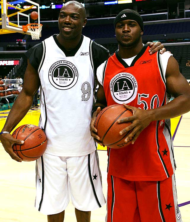 Bush with Terrell Owens at the Midsummer Night's Dream celebrity basketball game in Los Angeles.