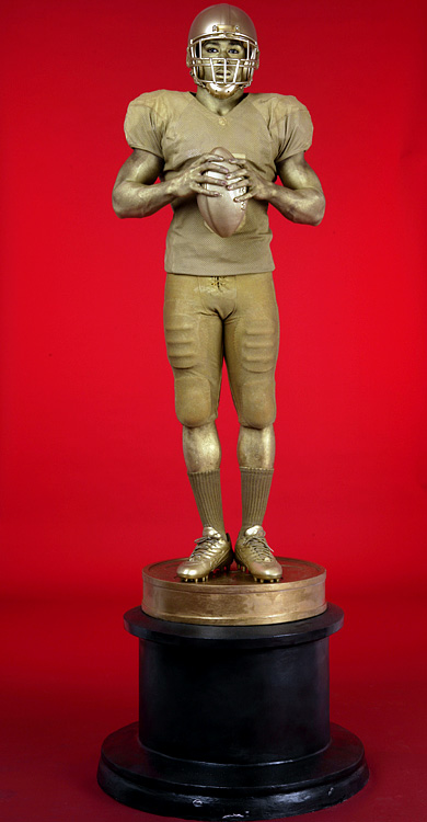 By 2005, Bush was the top prize in college football, so much so that he agreed to pose as an Oscar statue for an SI photo shoot.