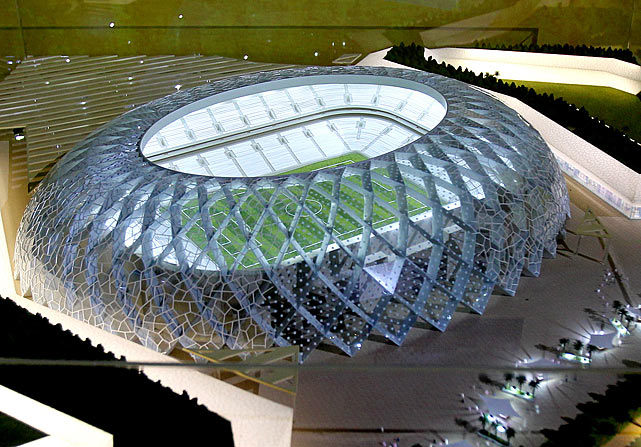A model of the Al-Wakra football stadium is displayed.