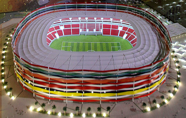 A model of the Al-Gharrafa stadium is displayed.