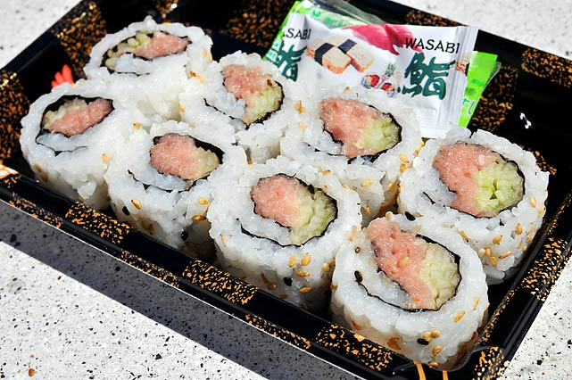 """It takes exactly like the sushi you'd get at your local supermarket. The rice is ridiculously cold. No sushi chef would ever serve it this way. It's been in that case for a couple hours, but it's not  bad . I normally try to shy away from raw fish at a sporting event, but these taste OK."""