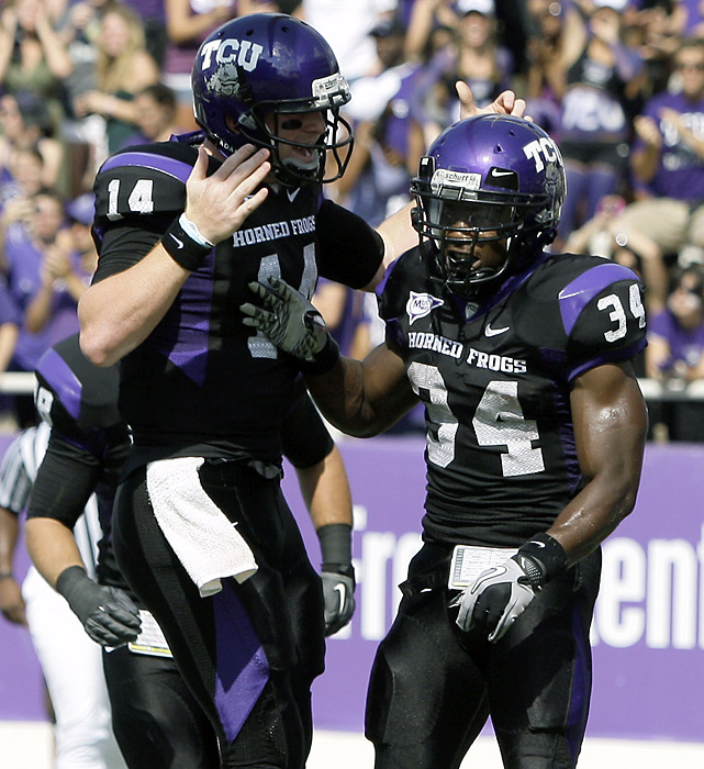 These two guys had big days at the office as Texas Christian cruised. Quarterback Andy Dalton (left) completed 21 of 23 passes for 267 yards and two touchdowns and running back Ed Wesley ran 19 times for 165 yards and two touchdowns as TCU scored touchdowns on their first five drives to build a 35-3 lead.