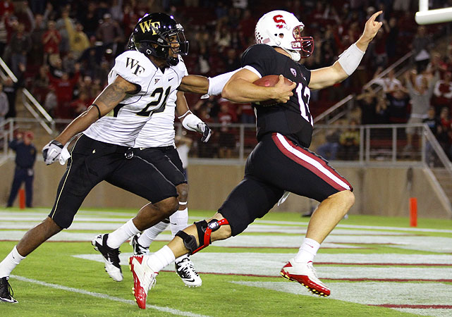 Stanford quarterback Andrew Luck passed for three touchdowns and ran for this 52-yard TD -- in the first 30 minutes -- as the Cardinal totaled 341 yards of offense while rolling to a 41-10 halftime lead over the visiting Demon Deacons.