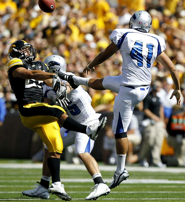 Iowa didn't need two blocked field goals to survive its 2010 opener like it did in 2009, but Paki O'Meara blocked a punt for good measure, and the Hawkeyes rolled behind a three-touchdown day from running back Adam Robinson.