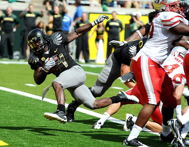 Star Oregon running back LaMichael James was suspended for the Ducks' opener, but it didn't matter: Backup Kenjon Barner scored four rushing touchdowns and also caught a touchdown pass, and Oregon rolled.