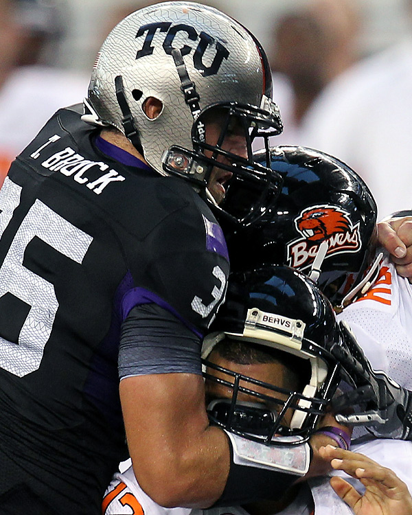 TCU's Tanner Brock lays the hammer down on Oregon State quarterback  Ryan Katz. TCU limited Oregon State to 13 first downs and 180 passing yards and 270 total yards.