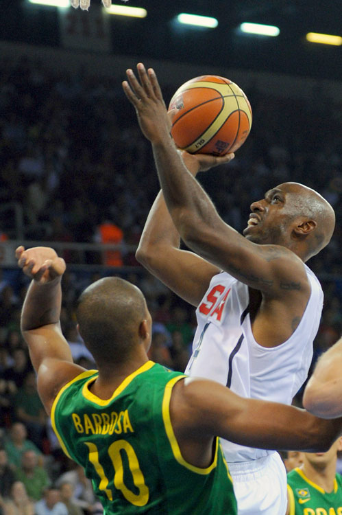 "In its toughest test of the tournament, Team USA was spared an early loss to Brazil after Leandro Barbosa's shot at the buzzer rimmed out. Kevin Durant poured in a game-high 27 points and 10 boards, but the 21-year-old credited his elder point guard for taking the guiding the team to victory. ""Chauncey [Billups] made some big plays,"" said Durant. ""He's the leader of this team so we got to follow him ... he did a great job of carrying us in the second half."" Billups had 15 points, including a few key baskets down the stretch to help the U.S. maintain its lead over a tenacious Brazilian team."