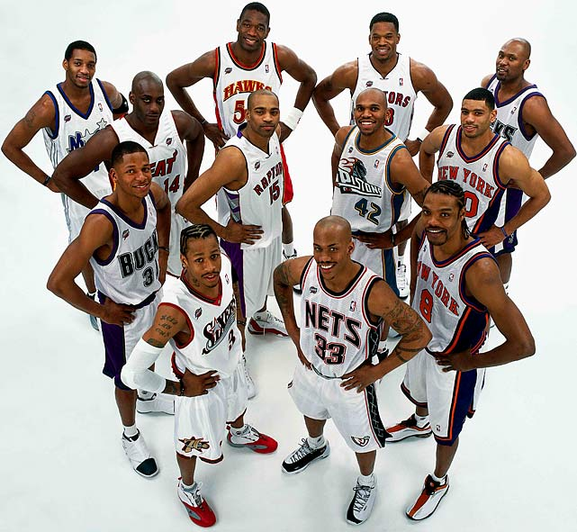 Iverson strikes a pose with his fellow Eastern Conference teammates during the NBA All-Star Weekend in 2001. Among a squad of superstars, Iverson shone the brightest -- scoring 15 points in the final nine minutes to earn All-Star Game MVP honors.