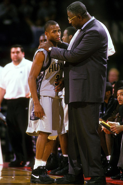 Georgetown coach John Thompson talks things over with Iverson during a 1995 game. The young guard was a phenom during his two years with the Hoyas: earning the Big East Rookie of the Year honors, claiming two Big East Defensive Player of the Year awards and averaging a school-record 23.0 points per game.