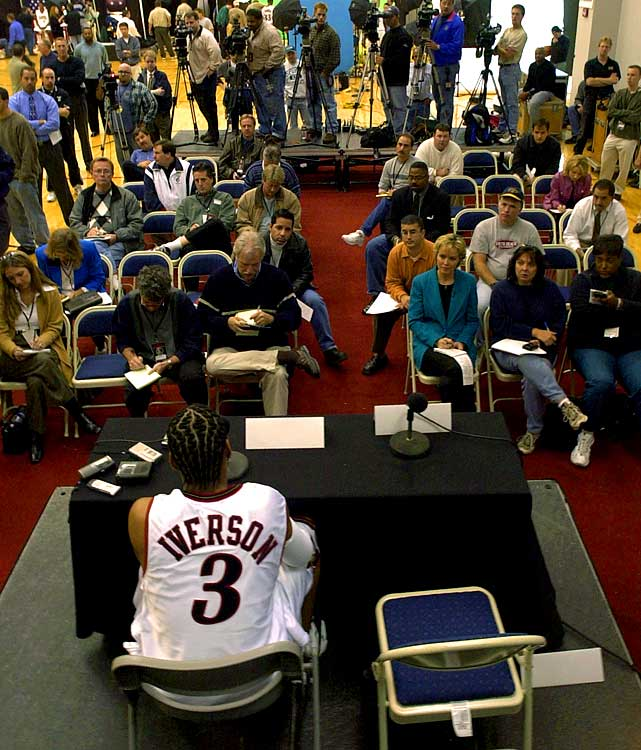 """We're not talking about a game. We're talking about practice."" A constant source of media attention, Iverson addresses a throng of reporters during the 76ers' media day in 2001. His famous ""practice"" rant would come a year later."