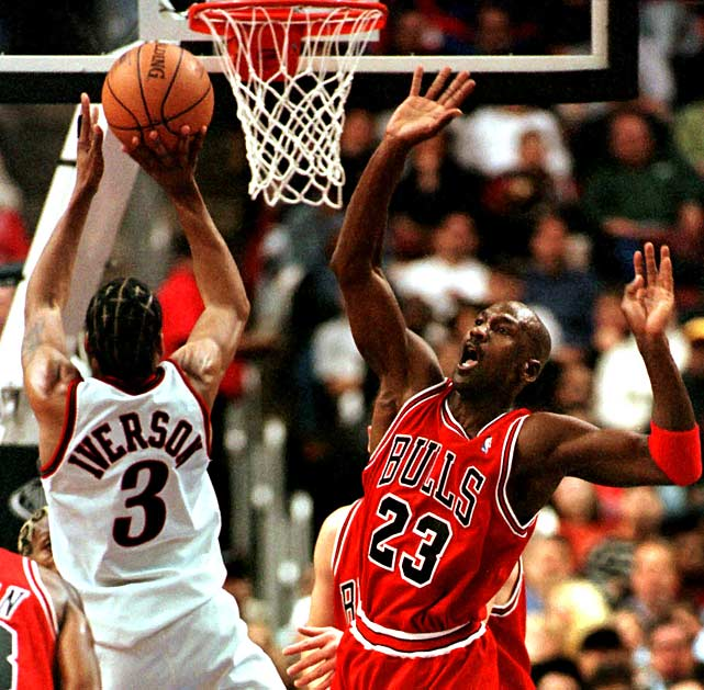 Iverson elevates over Michael Jordan during the Sixers' 1998 upset of the defending-champion Bulls. It was a sign of things to come as he captured his first scoring title and was named to his first All-NBA team at season's end.