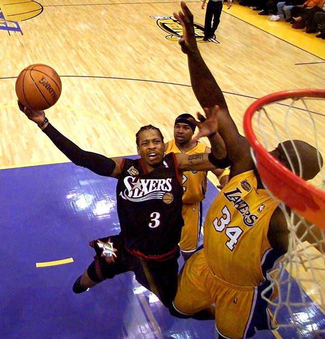 Iverson leaps to the basket around Shaquille O'Neal during Game 1 of the 2001 NBA Finals. Iverson wowed the Los Angeles crowd, racking up 48 points and six assists in the 76ers' overtime triumph. Philadelphia would drop the next four, and Iverson never returned to the Finals.