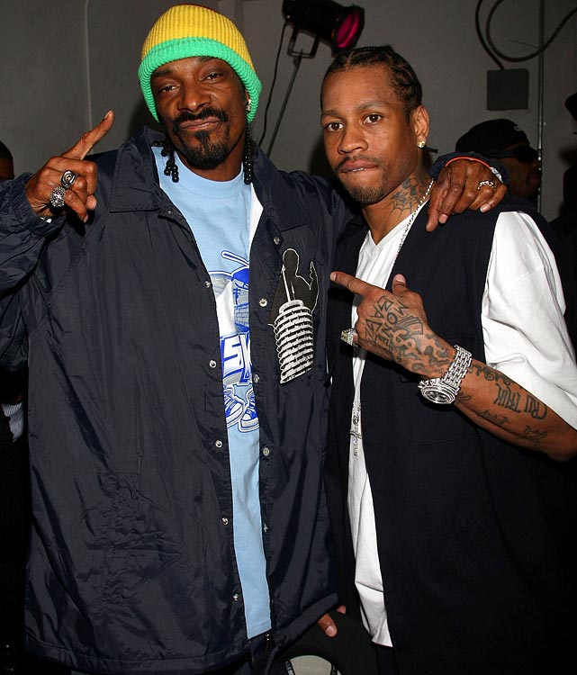 "Quite the celebrity, Iverson poses with Snoop Dogg during a New Year's Eve bash in Hollywood in 2009. In addition to basketball, he tested his skills in the rap-world as well, recording the single ""40 Bars"" in the 2000 offseason. The NBA refused its release because of its controversial lyrics."