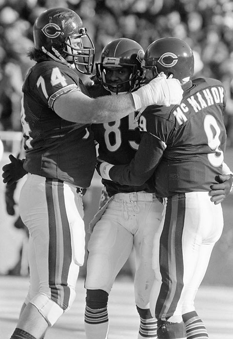 McMahon celebrates with Jim Covert (No. 74) and Dennis McKinnon (No. 85) after scoring a touchdown to go up 21-0 during the 1985 NFC Divisional Playoff game against the Giants. The Bears won 21-0.