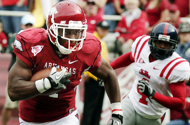 Twice, this game was delayed by lightning. Twice, the Rebels pulled within a touchdown of the Hogs. Twice, Arkansas running back Knile Davis answered with touchdown runs. Star quarterback Ryan Mallett again left the game injured (bruised throwing shoulder), but the Hogs prevailed on the strength of a 176-yard, three score day from Davis.
