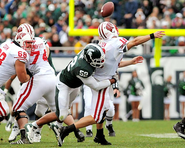 Michigan State overcame three first-half turnovers to knock off No. 11 Wisconsin and remain undefeated heading into next weekend's showdown with Michigan. The Spartans also overcame the absence of head coach Mark Dantonio, who suffered a heart attack on Sept. 19 and was hospitalized again on Thursday due to a blood clot in his leg.
