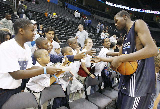 Embracing their new hometown hero, Oklahoma City Thunder fans greet Durant following an open practice.  Formerly the SuperSonics, the franchise moved to Oklahoma City in 2008.