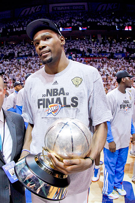 Durant stands with the Western Conference Finals Champions trophy following the Thunder's victory over the Spurs in Game 6 of the Western Conference Finals.