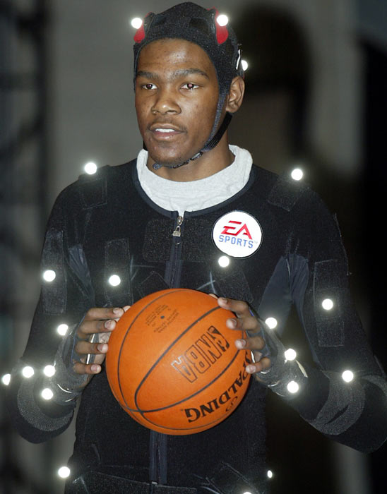 Decked from head to toe in light sensor technology, Durant handles the basketball while EA Sports captures his moves in its Burnaby, British Columbia studio.  Durant is compiling quite the video game resume.  After serving as the cover athlete for  NCAA March Madness '08 , he was placed on the front of  NBA Elite 11 .  Both are EA Sports titles.
