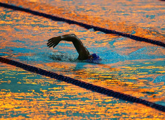 As the light painted the water shades of blue, yellow and orange, a swimmer trained at the Dr. S.P. Mukherjee Aquatics Complex in Delhi before the 2010 Commonwealth Games, which began last Sunday and are scheduled to run through Oct. 14.