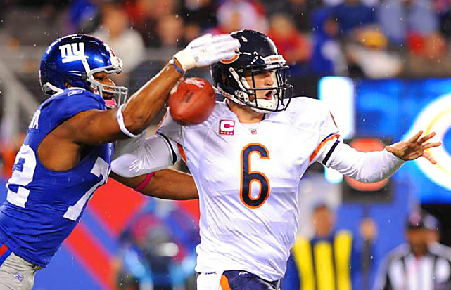 New York Giants defensive end Osi Umenyiora hits Chicago Bears quarterback Jay Cutler to break up a pass attempt. The Giants sacked Cutler nine times en route to a 17-3 victory.