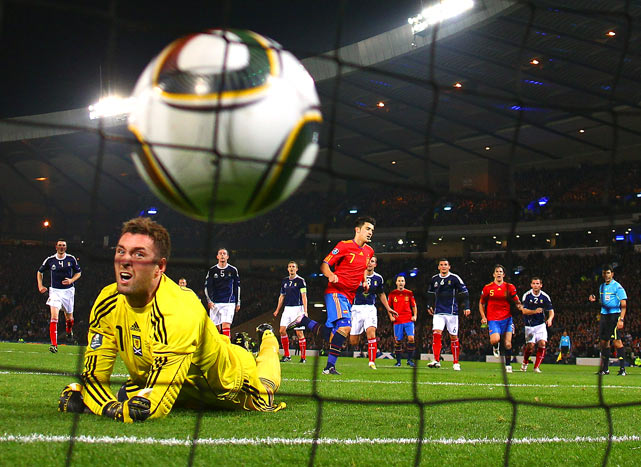 David Villa of Spain beats Allan McGregor of Scotland on a penalty shot for the opening goal during the UEFA EURO 2012 Group I Qualifier match between Scotland and Spain at Hampden Park on Oct. 12 in Glasgow.  Spain defeated Scotland 3-2.