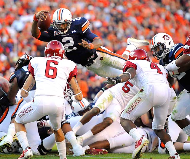 Auburn quarterback Cameron Newton dives over the pile for a touchdown in the Tigers 65-43 victory over Arkansas on Oct. 16 at Jordan Hare Stadium in Auburn.