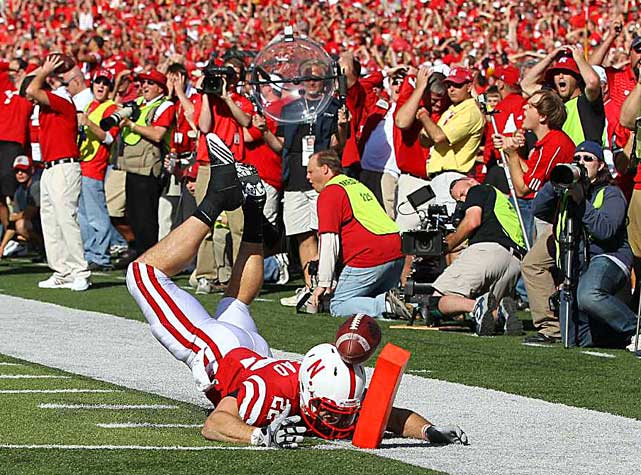Running back Rex Burkhead of the Nebraska Cornhuskers just misses a reception during a 20-13 loss to Texas at Memorial Stadium in Lincoln.